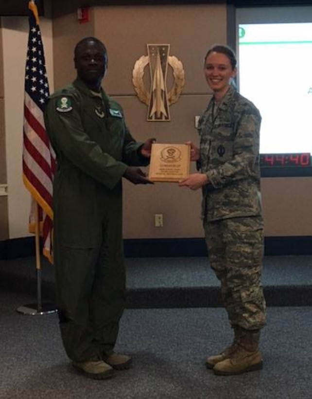 First Lt. Megan Willey, 321st Missile Squadron missile combat crew commander, poses for a picture accepting the Crew of the Quarter award for the 4th quarter, 2016. (U.S. Air Force courtesy photo)
