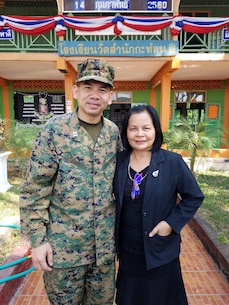 U.S. Navy Reserve Chaplain Aroon Seeda reunites with his primary school teacher Mrs. Pairor Sa-ngiemrat after more than 30 years during a visit to Wat Sam Nakkaton school on Feb. 14 near Sattahip, Thailand by U.S. service members for exercise Cobra Gold 2017. The Thai-U.S. co-sponsored exercise represents the longstanding friendship between the Thai and American people and their commitment to work together in support of peace and security in the region.