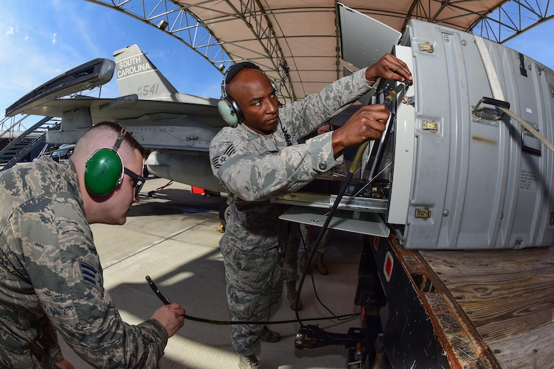 U.S. Air Force Staff Sgt. Timothy Harris-Bey, right, and Senior Airman Brock Latham, both inspectors from the 16th Electronic Warfare Squadron at Eglin Air Force Base, Fla., run tests on one of the South Carolina Air National Guard's F-16 Fighting Falcons at McEntire Joint National Guard Base, Jan. 18, 2017. The electronic warfare systems used on S.C. Air National Guard F-16 Fighting Falcons underwent an annual Combat Shield inspection; ensuring testing and maintenance requirements are properly conducted. (U.S. Air National Guard photo by Airman 1st Class Megan Floyd)