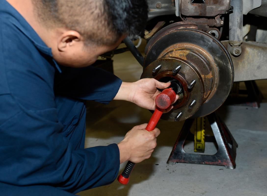 U.S. Air Force Senior Airman Evin Diaz, 733rd Logistics Readiness Squadron vehicle maintainer, replaces a vehicle's wheel bearing after it is coated with a bio-based grease at Joint Base Langley-Eustis, Va., Jan. 31, 2017. A 12-month long experiment, will be performed on vehicles across the installation, to observe the impact that the bio-based grease has on vehicle life and maintenance longevity. (U.S. Air Force photo by Airman 1st Class Kaylee Dubois)