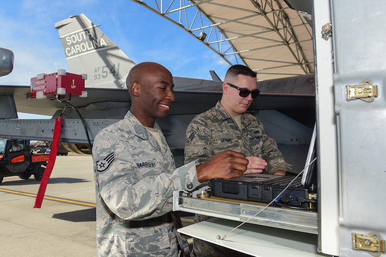 U.S. Air Force Staff Sgt. Timothy Harris-Bey, left, and Senior Airman Brock Latham, right, both inspectors from the 16th Electronic Warfare Squadron at Eglin Air Force Base, Fla., run tests on  one of the South Carolina Air National Guard's F-16 Fighting Falcons at McEntire Joint National Guard Base, Jan. 18, 2017. The electronic warfare systems used on S.C. Air National Guard F-16 Fighting Falcons underwent the annual inspection; ensuring testing and maintenance requirements are properly conducted. (U.S. Air National Guard photo by Airman 1st Class Megan Floyd)