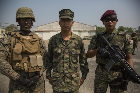 Service members from the U.S., Thailand, and Malaysia guard the processing center for a noncombatant evacuation operation, as part of Cobra Gold 17 at Naval Airbase Utapao, Thailand, Feb. 19, 2017. The drill was conducted to exercise joint, multinational cooperation during disaster relief. Cobra Gold is the largest Theater Security Cooperation exercise in the Indo-Asia-Pacific region and is an integral part of the U.S. commitment to strengthen engagement in the region. U.S., Thai, Malaysian and Japanese forces participated in the disaster relief drill.