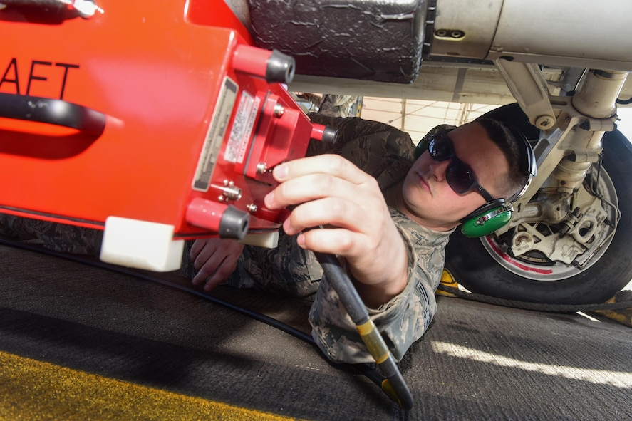 U.S. Air Force Senior Airman Brock Latham, inspector from the 16th Electronic Warfare Squadron at Eglin Air Force Base, Fla., removes a testing device from one of the South Carolina Air National Guard's F-16 Fighting Falcons at McEntire Joint National Guard Base, Jan. 18, 2017. The electronic warfare systems used on S.C. Air National Guard F-16 Fighting Falcons underwent an annual Combat Shield inspection; ensuring testing and maintenance requirements are properly conducted.   (U.S. Air National Guard photo by Airman 1st Class Megan Floyd)
