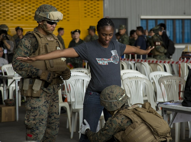 U.S. Marines pat down a role player for contraband during a noncombatant evacuation operation, as part of Cobra Gold 17 at Naval Airbase Utapao, Thailand, Feb. 19, 2017. The drill was conducted to exercise joint, multinational cooperation during disaster relief. Cobra Gold is the largest Theater Security Cooperation exercise in the Indo-Asia-Pacific region and is an integral part of the U.S. commitment to strengthen engagement in the region. U.S., Thai, Malaysian and Japanese forces participated in the disaster relief drill.