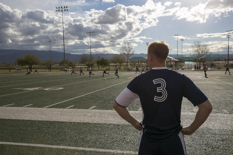 A player with 29 Palms Futbol Club waits for a substitution during a pre-season game versus Pendleton FC at Felix Field aboard Marine Corps Air Ground Combat Center, Twentynine Palms, Calif., Feb. 11, 2017. 29 Palms FC is preparing for a tournament at Fort Irwin National Training Center in April. (U.S. Marine Corps photo by Lance Cpl. Dave Flores)