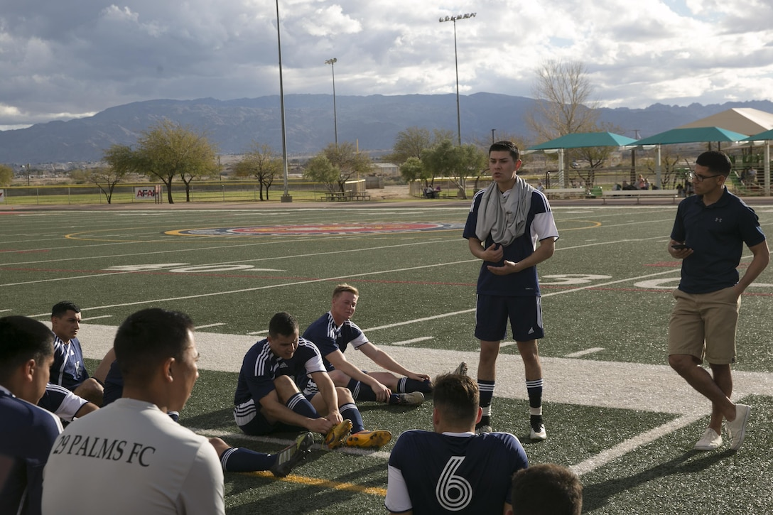 Cpl. Marco A. Perez, coach and player, 29 Palms Futbol Club speaks to his team at half-time during a pre-season game versus Pendleton FC at Felix Field aboard Marine Corps Air Ground Combat Center, Twentynine Palms, Calif., Feb. 11, 2017. 29 Palms FC is preparing for a tournament at Fort Irwin National Training Center in April. (U.S. Marine Corps photo by Lance Cpl. Dave Flores)