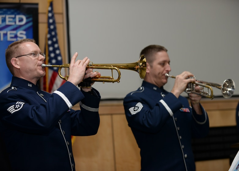 Staff Sgt. Daniel Thrower, a musician assigned to Offutt Brass, the brass ensemble of the U.S. Air Force Heartland of America Band, plays his trumpet during a performance at Mount Rushmore, S.D., Feb. 20, 2017. To celebrate President's Day, members of Offutt Brass played music celebrating America and patriotism. (U.S. Air Force photo by Senior Airman Anania Tekurio)