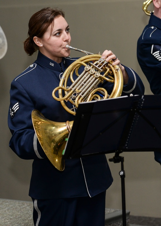 Senior Airman Alena Zidlicky, a musician assigned to Offutt Brass, the brass ensemble of the U.S. Air Force Heartland of America Band, plays her French horn during a performance at Mount Rushmore, S.D., Feb. 20, 2017. Offutt Brass will perform throughout western South Dakota, playing music from classical to jazz as well as patriotic tunes. (U.S. Air Force photo by Senior Airman Anania Tekurio)