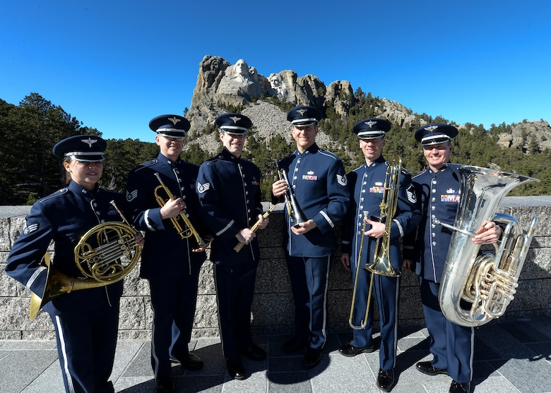 To celebrate President's Day, Offutt Brass, the brass ensemble of the U.S. Air Force Heartland of America Band, performed at Mount Rushmore, S.D., Feb. 20, 2017. The audience was treated to music of patriotic fervor and had an opportunity to learn about the ensemble's role within the Air Force. (U.S. Air Force photo by Senior Airman Anania Tekurio)