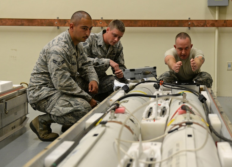 From left, U.S. Air Force Airman 1st Class Richard Melton, Senior Airman Rand McCrady and Staff Sgt. Jeffrey Davies, assigned to the 36th Munitions Squadron, inspect an AGM-88 high-speed anti-radiation missile (HARM) Jan. 26, 2017, at Andersen Air Force Base, Guam. The 36th MUNS recently opened their new precision-guided munitions shop in early January 2017, where Airmen test, inspect and update missiles. (U.S. Air Force photo by Senior Airman Alexa Ann Henderson)