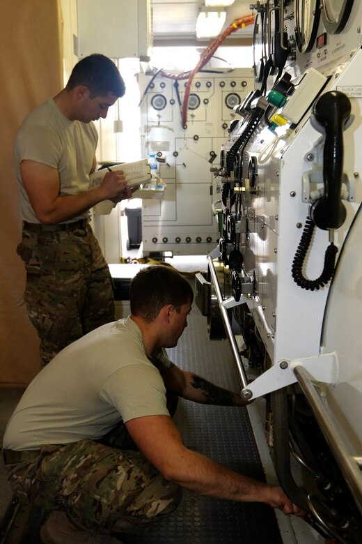 Salvage diver Spc. Nathaniel Marquez (back) and Sgt. Christopher Miller, both with 511th Engineer Dive Detachment out of Fort Eustis, Va., do maintenance checks on a Standard Navy Double Lock Recompression Chamber System, at Kuwait Naval Base, Kuwait, Feb. 02, 2017. The maintenance check is in preparation of training soldiers in operation of the chamber, Soldier advancement and to help a soldier with an injury sustained during a previous training exercise.