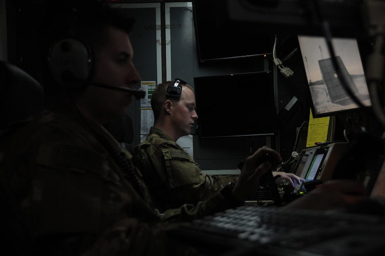Senior Airman James, left, 46th Expeditionary Reconnaissance Squadron sensor operator, and 1st Lt. Matthew, right, 46th ERS pilot, sit inside a ground station control at an undisclosed location in Southwest Asia Feb. 14, 2017. The 46th ERS Airmen conduct launch and recoveries of MQ-1 Predator remotely piloted aircraft in support of Operation Inherent Resolve. (U.S. Air Force photo/Tech. Sgt. Kenneth McCann)