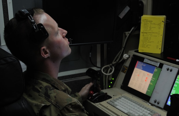 1st Lt. Matthew, 46th Expeditionary Reconnaissance Squadron pilot, looks over the control panels inside a ground control station Feb. 14, 2017 at an undisclosed location in Southwest Asia. Matthew conducts the launch and recovery phase of flight for the MQ-1 Predator mission at the 386th Air Expeditionary Wing.  (U.S. Air Force photo/Tech. Sgt. Kenneth McCann)