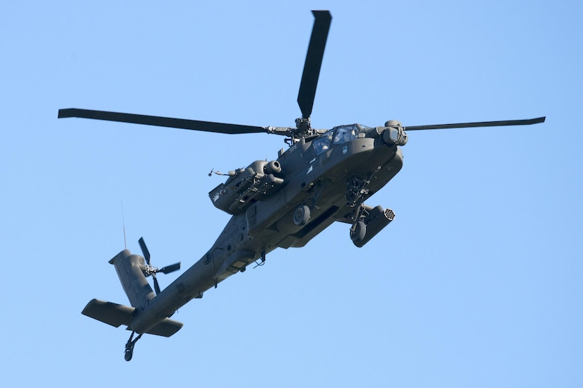 An AH-64 Apache attack helicopter conducts flight operations at Travis Air Force Base, Calif., Jan, 6, 2017. This aircraft is the U.S. Army's heavy division/corps attack helicopter.  The AH-64 Apache is a four-blade attack helicopter with reverse-tricycle landing gear, and features a tandem cockpit for a crew of two. Air Force photo by Heide Couch