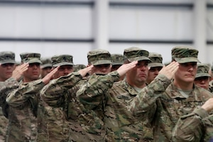 Soldiers from 2nd Battalion, 162nd Infantry Regiment, Oregon Army National Guard, render a salute during the National Anthem at  their demobilization ceremony in Albany, Oregon, June 13. The 2-162nd Infantry Battalion spent approximately 10-months in Kabul, Afghanistan, performing various security duties and training Afghan National Police forces.