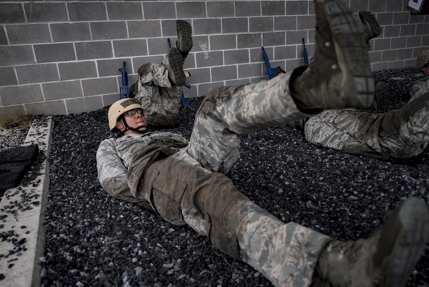 Air Force Academy Cadet Jones conducts flutter kicks during an Air Liaison Officer Aptitude Assessment, Feb. 14, 2017, at Camp Bullis, Texas. The cadets were divided into two groups for the tasked obstacle portion of the assessment, leaving the other group time to work out. (U.S. Air Force photo by Airman 1st Class Daniel Snider)