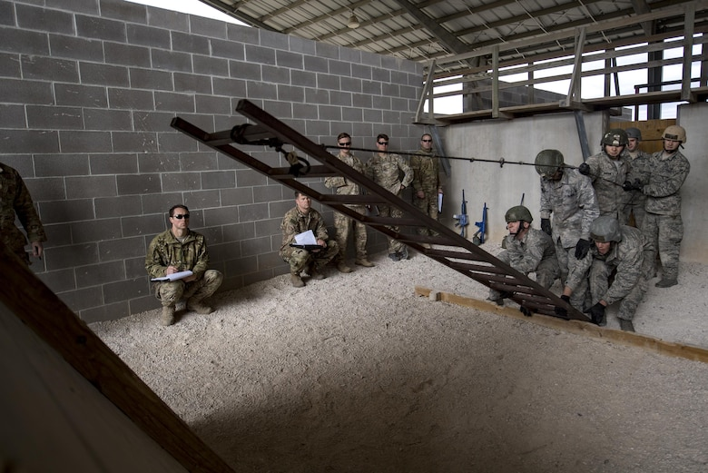 Air Force Academy Cadets work to complete a tasked obstacle during an Air Liaison Officer Aptitude Assessment, Feb. 14, 2017, at Camp Bullis, Texas. The cadets were forced to use critical thinking skills to complete tasked obstacles as a team. (U.S. Air Force photo by Airman 1st Class Daniel Snider)