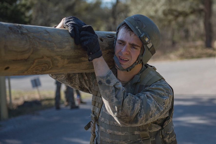 Air Force Academy Cadet Ervin carries a log over his shoulder during a medical evacuation march at an Air Liaison Officer Aptitude assessment, Feb. 16, 2016, at Camp Bullis, Tx. The week-long assessment allows current ALOs and enlisted cadre to decide if the cadets are worthy of progressing to the Tactical Air Control Party schoolhouse. (U.S. Air Force photo by Airman 1st Class Daniel Snider)