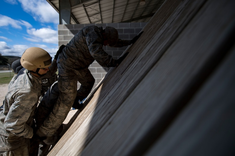 Air Force Academy cadets work to complete a tasked obstacle training during an Air Liaison Officer Aptitude Assessment, Feb. 14, 2017, at Camp Bullis, Texas. The cadets were forced to use critical thinking skills to complete tasked obstacles as a team. (U.S. Air Force photo by Airman 1st Class Daniel Snider)