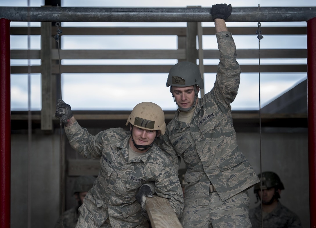 U.S. Air Force Academy cadets participate in a skills building task during the Air Liaison Officer Aptitude Assessment, Feb. 14, at Camp Bullis, Texas. The cadets were forced to use critical thinking skills to complete tasked obstacles as a team. (U.S. Air Force photo by Tech. Sgt. Zachary Wolf)