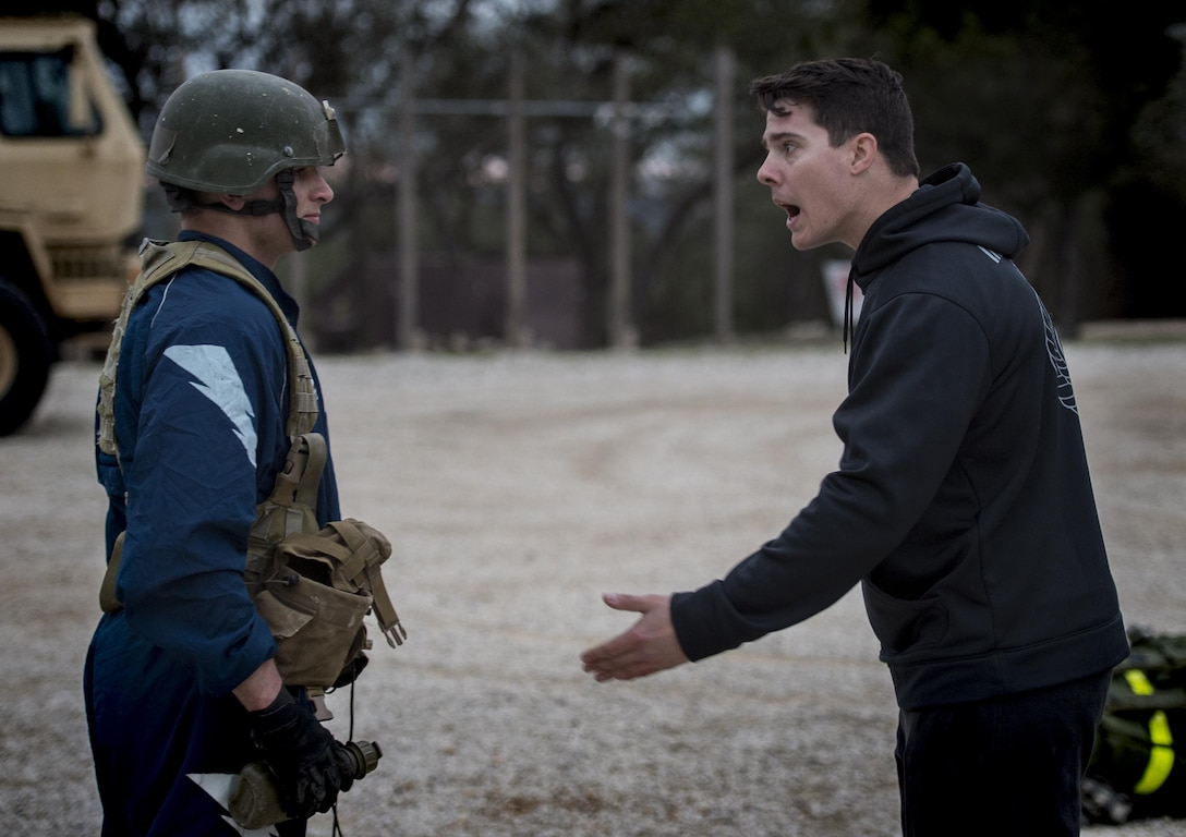 Staff Sgt. Daniel Clark, 553d Battlefield Airmen Training Squadron Tactical Air Control Party instructor, yells at U.S. Air Force Academy Cadet Bowman Benge during the Air Liaison Officer Aptitude Assessment, Feb. 14, at Camp Bullis, Texas. The week-long assessment allows current ALOs and enlisted cadre to decide if the cadets are worthy of progressing to the Tactical Air Control Party school house. (U.S. Air Force photo by Tech. Sgt. Zachary Wolf)
