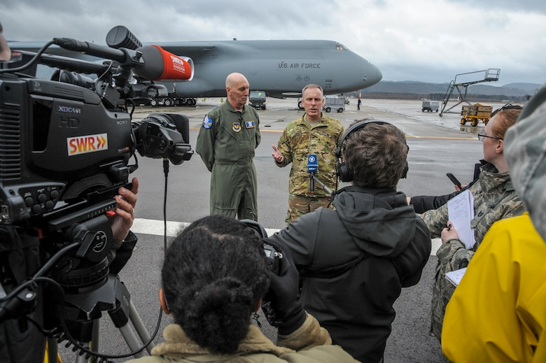 Maj. Gen. Timothy Zadalis, vice-commander, U.S. Air Forces in Europe and Air Forces Africa, and Army Brig. Gen. Phillip Jolly, Deputy Commanding General, Mobilization and Reserve Affairs Director, speak to reporters during the arrival of four Army AH-64 Apache helicopters at Ramstein Air Base, Germany Feb. 22, 2017. The Apache's arrived on two Air Mobility Command C-5M Galaxies. (U.S. Air Force photo/Staff Sgt. Timothy Moore)