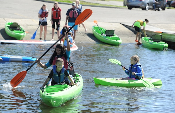 Keesler personnel and family members steer their kayaks through the Keesler Marina during the Polar Bear Regatta at Marina Park Feb. 18, 2017, on Keesler Air Force Base, Miss. Keesler Outdoor Recreation sponsored the event, providing kayaks and paddle boards for use. (U.S. Air Force photo by Kemberly Groue)