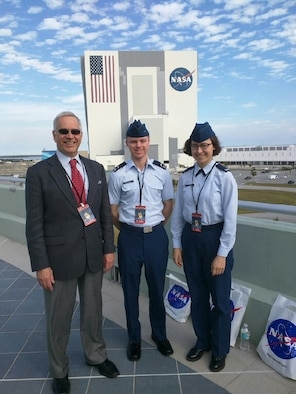 Dr. Geoff McHarg (left), director of the Space Physics and Atmospheric Research Center at the U.S. Air Force Academy, stands with Cadet 3rd Class Nick McDaniel (middle) and Cadet 4th Class Sequoia Chun, in front of the Vehicle Assembly Building at Cape Canaveral, Florida, Feb. 19, 2017. The trio attended the Space-X CRS-10 launch taking the latest Academy space experiment to the International Space station. (U.S. Air Force photo)