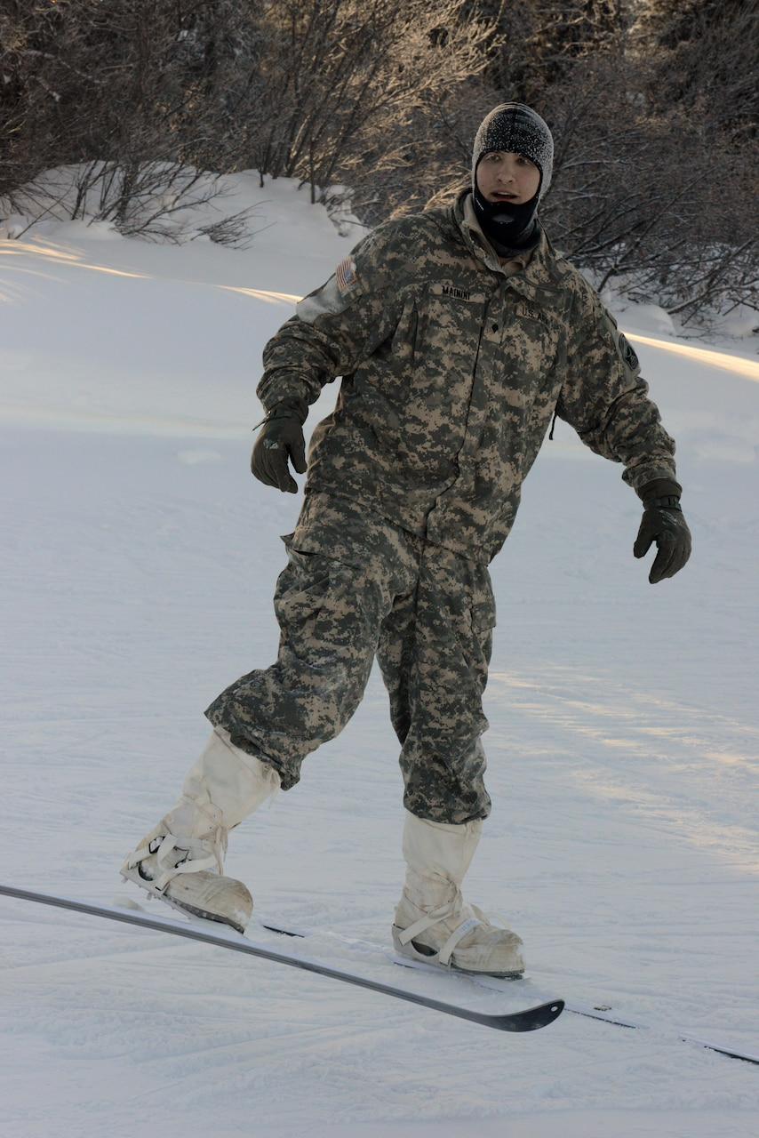 An instructor at the Northern Warfare Training Center in Alaska test-wears an Arctic camouflaged cold-weather uniform, Feb. 12, 2017. DoD photo by David Vergun
