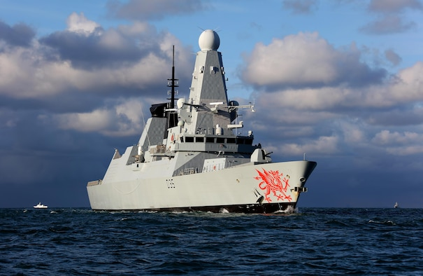The HMS Dragon, a Royal Navy warship, rescues 14 stricken sailors from damaged British racing yacht Feb. 11, 2017, on the Atlantic Ocean. HMS Dragon was diverted 500 miles away from a routine tasking to provide life-saving assistance to the crew of the 60ft Clyde Challenger racing yacht. (Courtesy photo by Royal Navy)
