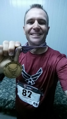 After his 3rd treatment of Chemotherapy in Dallas, Texas, Senior Airman Cameron Sowle competed in 5K Air Force Marathon 24 Dec 2015 (Courtesy Photo).