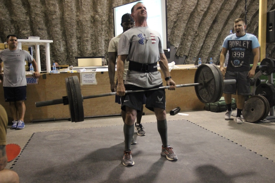 Shortly before his cancer diagnosis, Senior Airman Cameron Sowle competes in a weightlifting competition during his deployment in Oct 2015 (Courtesy Photo).