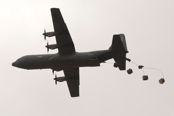 An aircrew assigned to the 327th Airlift Squadron airdrops water barrel container delivery system (CDS) bundles from a C-130J Super Hercules over Blackjack Drop Zone Feb. 11, 2017, near Beebe, Ark. The 327th AS is part of the 913th Airlift Group at Little Rock Air Force Base, Ark. (U.S. Air Force photo by Master Sgt. Jeff Walston/Released)