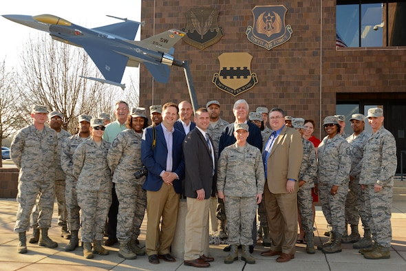 U.S. Air Force Staff Sgt. Angela Duff, 20th Logistics Readiness Squadron quality assurance evaluator, center right, stands with Team Shaw members and Sumter community leaders at Shaw Air Force Base, S.C., Feb. 14, 2017. The Greater Sumter Chamber of Commerce Military Affairs committee recognized Duff as the 2016 Military Citizen of the Year for outstanding merit. (U.S. Air Force photo by Airman 1st Class Kathryn R.C. Reaves)
