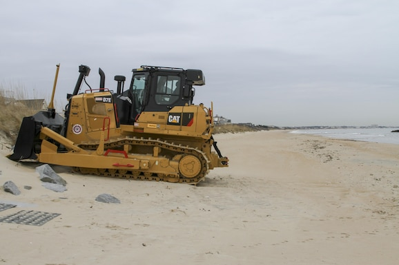 NORFOLK, VA – Heavy equipment is staged along the beach in Norfolk, Virginia's East Ocean View neighborhood. Contractors will use the equipment to move dredged up sand on the beach to create a 60 foot wide beach berm that slopes to 5 feet above mean low water. Engineers' designed the beach to absorb the wave energy, protecting critical infrastructure during coastal storms. (U.S. Army photo/Patrick Bloodgood)