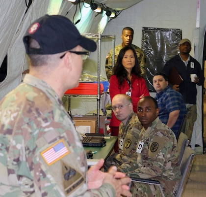 Sgt. 1st Class Lemuel Rodriguez-Velez (left), U.S. Army Medical Department Board test site NCOIC, briefs test players Jan. 24 at Joint Base San Antonio-Camp Bullis on what to expect during the testing of Theater Medical Information Program software, which is part of the Medical Communications for Combat Casualty Care program, or MC4, the Army's deployable electronic medical record system.