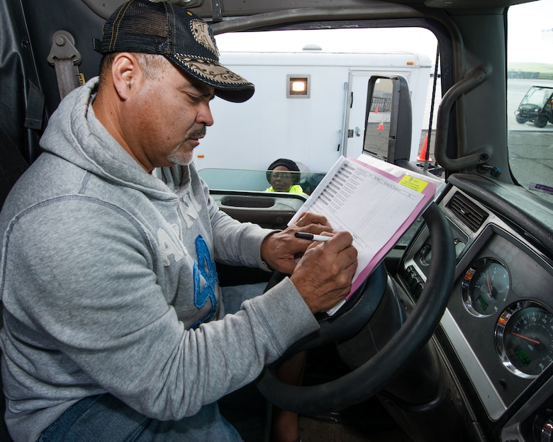 Juan Arriaga, a truck driver for the Federal Emergency Management Agency delivers supplies to Travis Air Force Base, Calif., Feb. 16, 2017. Travis AFB is acting as a staging area for FEMA personnel, providing space for necessary equipment and supplies in case of the Oroville auxiliary spillway failure. (U.S. Air Force photo/Louis Briscese)