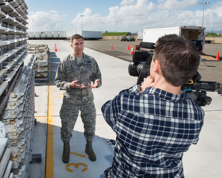 U.S. Air Force Col. John Klein, 60th Air Mobility Wing commander, conducts an interview with local media at Travis Air Force Base, Calif., Feb. 16, 2017. Travis AFB is acting as a staging area for FEMA personnel, providing space for necessary equipment and supplies in case of the Oroville auxiliary spillway failure. (U.S. Air Force photo/Louis Briscese)
