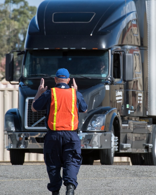 Trucks and personnel from the Federal Emergency Management Agency arrive at Travis Air Force Base, Calif., Feb. 16, 2017. Travis AFB is acting as a staging area for FEMA personnel, providing space for necessary equipment and supplies in case of the Oroville auxiliary spillway failure. (U.S. Air Force photo/Louis Briscese)