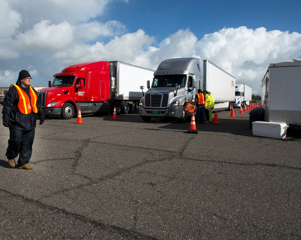 Trucks and personnel from the Federal Emergency Management Agency (FEMA) arrive at Travis Air Force Base, Calif., Feb. 16, 2017. Travis AFB is acting as a staging area for FEMA personnel, providing space for necessary equipment and supplies in case of the Oroville auxiliary spillway failure. (U.S. Air Force photo/Louis Briscese)