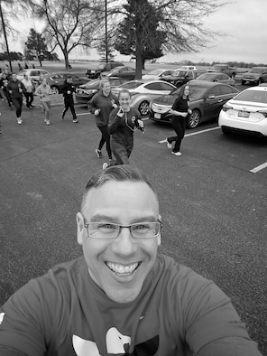 Christopher Parr, 932nd Airlift Wing Public Affairs specialist snaps a quick photo, during the warm up laps, before starting the Monday workout for the running clinic, Feb. 6, 2017, Scott Air Force Base, Illinois.  You can follow along with Parr's adventures in running by checking out his weekly blog in the commentaries section.  (U.S. Air Force photo by Christopher Parr)