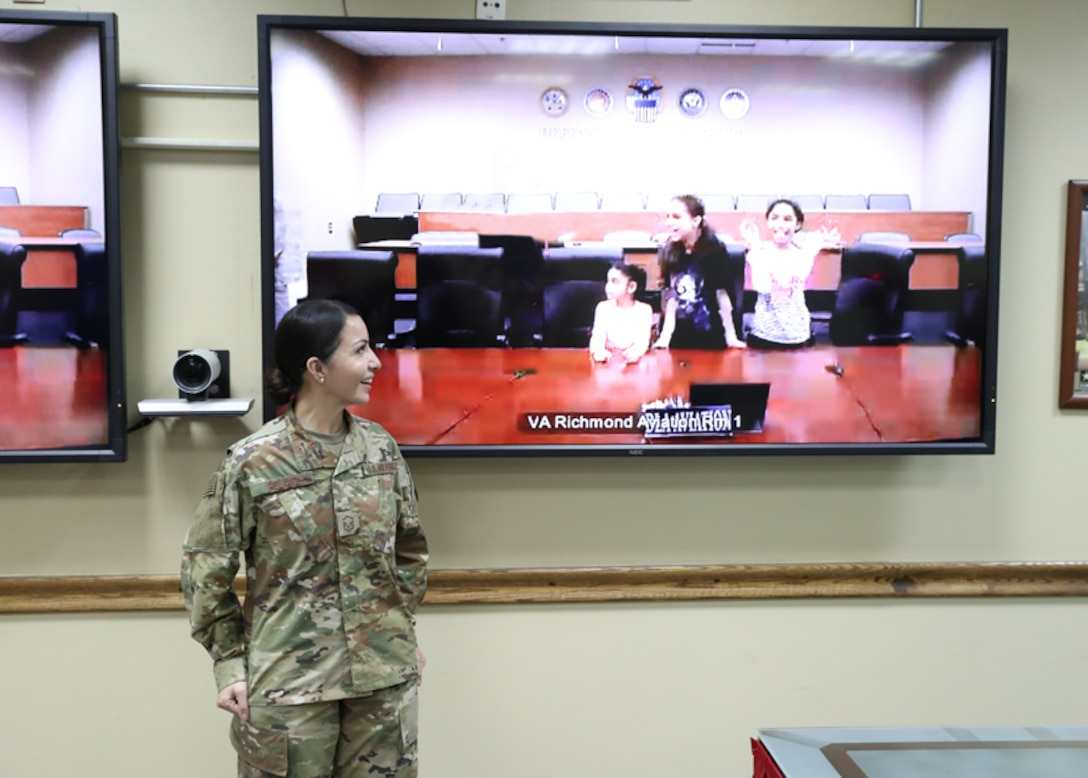 Air Force Tech. Sgt. Janet Pelayo, Defense Logistics Agency Aviation, celebrates her promotion ceremony Jan 31, 2017 held at Camp Arifjan, Kuwait, with her daughters watching through the use of video teleconferencing technology at Defense Supply Center Richmond, Virginia.