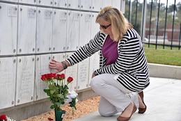 The daughter of Chief Master Sgt. Arthur Arehart Sr., U.S. Air Force, pays respect to her late father at the Barrancas National Cemetery at the Naval Air Station-Pensacola, Fl., Feb. 14. The final resting place for Arehart is in a section of columbarium that the U.S. Army Corps of Engineers, Mobile District, constructed last year.
