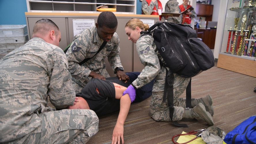 Medics from the 377 Medical Group tend to a patient during an active shooter exercise at the medical group clinic Feb. 21.  (U.S. Air Force Photo/Senior Airman Chandler Baker)