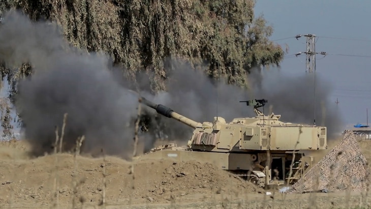 Soldiers fire an M109A6 Paladin from a tactical assembly area support the start of the Iraqi security forces' offensive in West Mosul, Iraq, Feb. 19, 2017. Army photo by Staff Sgt. Jason Hull