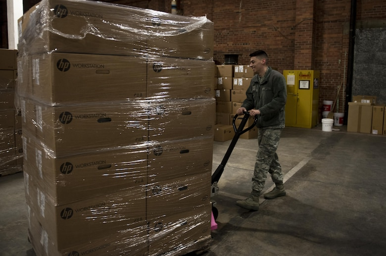 Airman 1st Class Josiah Massari, 92nd Communication Squadron base equipment custodian, places a pallet of equipment in the 92nd CSS warehouse Feb. 17, 2017, at Fairchild Air Force Base. Accountability of items in Information Technology Asset Management is done by scanning numbers on the items and making sure they line up with the numbers in the Automatic Information Manager program.  (U.S. Air Force photo/ Airman 1st Class Sean Campbell)