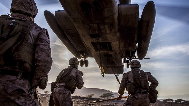 Marines prepare to attach a concrete barrier to a CH-53E Super Stallion during helicopter load training at Arta Beach, Djibouti, Feb. 16, 2017. Marine Corps photo by Lance Cpl. Brandon Maldonado
