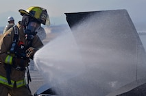 Takuto Hatayama, 374th Civil Engineer Squadron Fire Department fire fighter, puts out an engine fire during a vehicle fire training scenario at Yokota Air Base, Japan, Feb. 16, 2017. Yokota's personnel trained with the Japan Self-Defense Force and Fussa fire departments to gain different perspectives on putting out vehicle fires. (U.S. Air Force photo by Staff Sgt. David Owsianka)