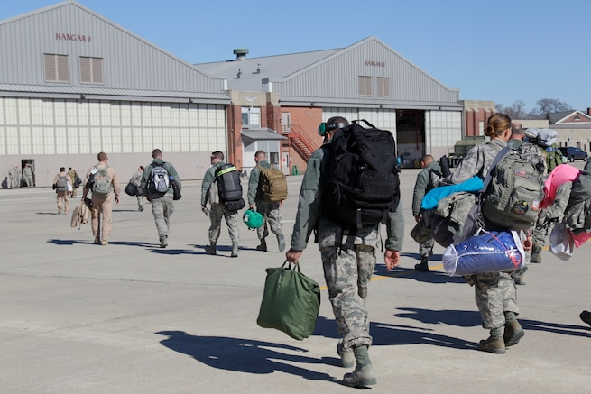 170219-Z-NQ307-141 -- Airmen from the 127th Air Refueling Group walk across the airfield at Selfridge Air National Guard Base, Mich. to in process upon return from their deployment. Approximately 85 Airmen and three aircraft from the Michigan Air National Guard's 127th ARG returned from a 60 day deployment to the Central Command area of responsibility on February 19th, 2017. (U.S. Air National Guard photo by TSgt. Rachel Barton)