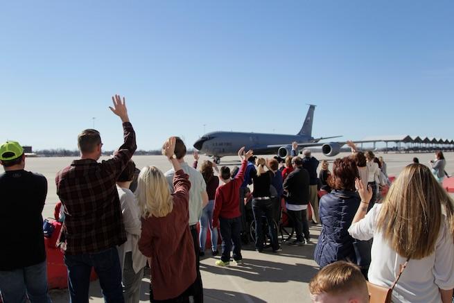 170219-Z-NQ307-070 -- Family members wave at a KC-135 Stratotanker flown by the 127th Air Refueling Group as it taxis in to park at Selfridge Air National Guard Base, Mich. on February 19th, 2017. Approximately 85 airmen and three aircraft from the Michigan Air National Guard's 127th ARG returned from a 60 day deployment to the Central Command area of responsibility. (U.S. Air National Guard photo by TSgt. Rachel Barton)